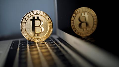Bitcoin soars to record high above $6,000