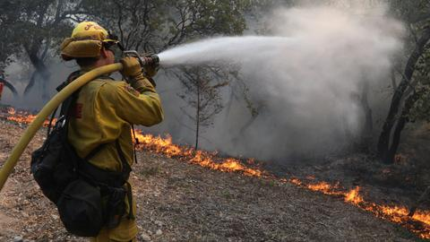 Shifting winds fuel wildfires in California as death toll climbs to 40