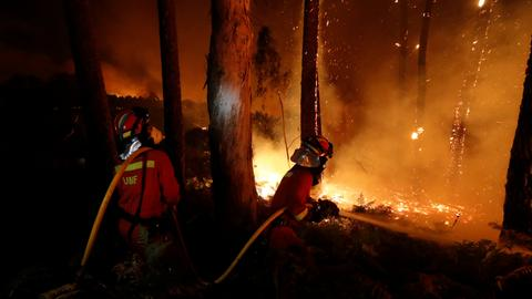 Wildfires kill at least 39 in Portugal and Spain