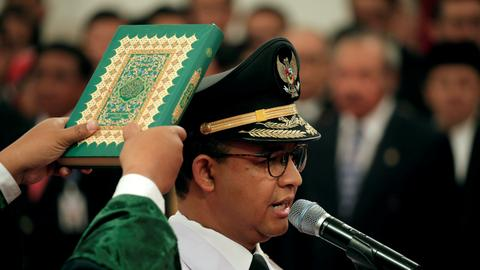 Jakarta governor sworn in after divisive campaign