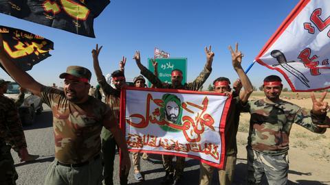 Iraqi forces and Shia militias recapture territory in northern Iraq
