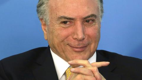 Brazilian president survives initial vote on corruption charges