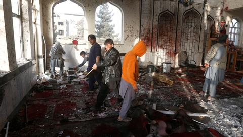 At least 89 killed in bombings on two Afghan mosques