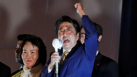 Japan's Abe looks set to win snap election with a two-thirds majority