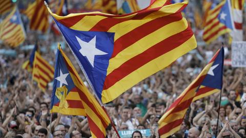 Catalan separatists threaten mass civil disobedience