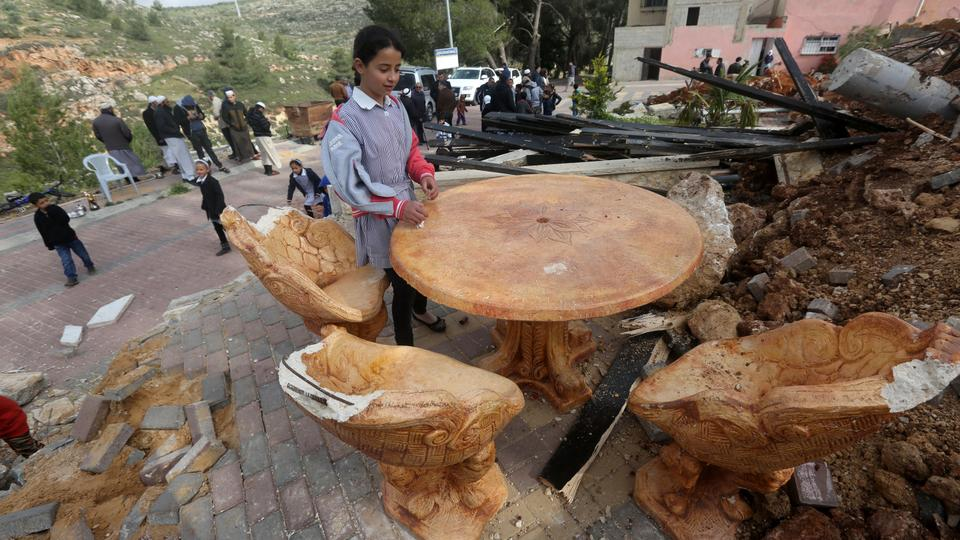 Palestinian children check the destruction in a children's playground, that was built with funding from Belgium, in Zatarah village, south of the West Bank city of Nablus, after it was demolished on April 12, 2016 by Israeli authorities who said it was built in Area C, a closed military zone where Israel exercises full control. Israel often demolishes buildings constructed without the required Israeli permits in Area C of the West Bank, which is under full Israeli control. (AFP)
