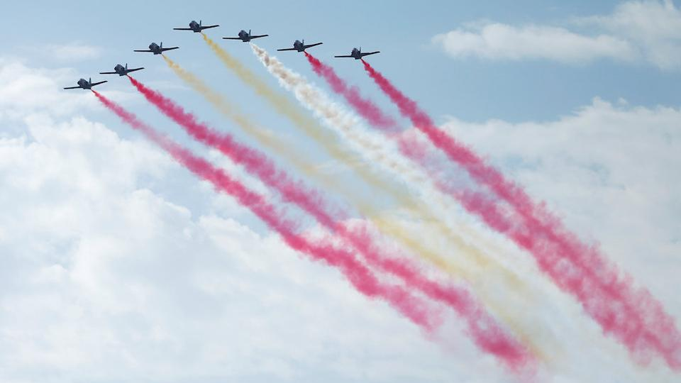 The Spanish Air Force's aerobatic display team the Patrulla Aguila (Eagle Patrol) take part in a flypast as part of celebrations to mark Spain's National Day in Madrid, Spain October 12, 2017.  (Reuters)