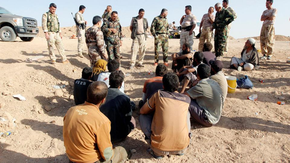 Kurdish Peshmerga forces detain Daesh militants southwest of Kirkuk, Iraq October 5, 2017.