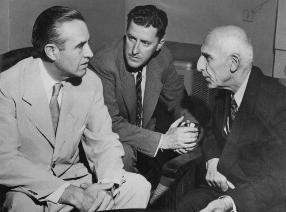 US President Harry Truman's personal foreign policy adviser, W Averell Harriman, (L), conferring with Prime Minister Mohammed Mossadegh of Iran in 1951. An interpreter sits between them.