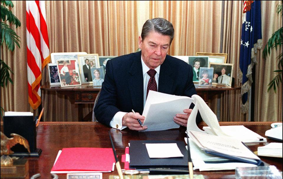 The US president Ronald Reagan was involved in the Iran-Contra scandal, pictured in the Oval Office in 1988.