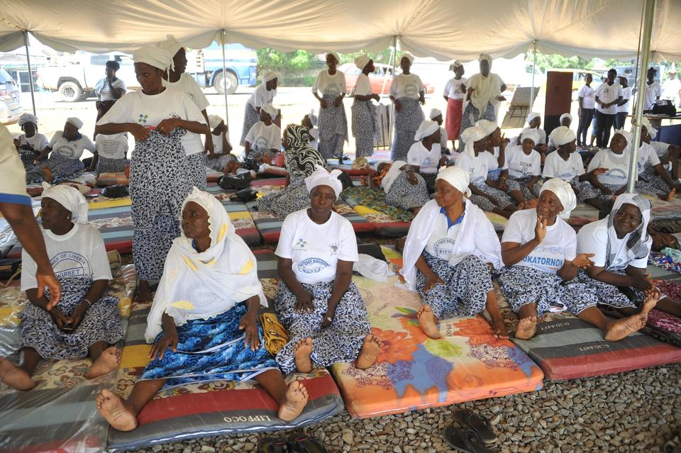 Members of the Women in Peacebuilding Network sit on mattresses under a tent as they fast to call for peaceful elections in Monrovia on October 5, 2017. Ahead of elections, women of all ages gathered from dawn to sunset on a roadside close to the party headquarters of several presidential candidates, in an echo of protests that eventually helped bring an end to Liberia's back-to-back 1989-2003 civil wars.
