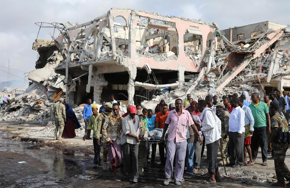 Rescue workers with flashlights overnight searched for survivors trapped under the rubble of the largely destroyed Safari Hotel, which is close to Somalia's foreign ministry. The explosion blew off metal gates and blast walls erected outside the hotel.