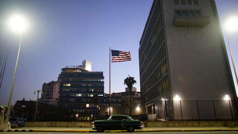 US cuts 60 percent embassy staff to Cuba