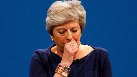 Prankster, coughing fits interrupts May's keynote speech