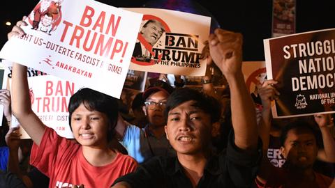 Trump lands in Philippines, offers to mediate on South China Sea