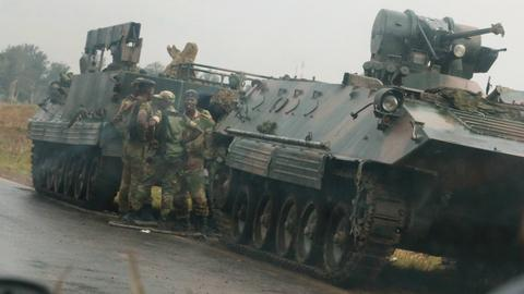 Armoured vehicles roll into Zimbabwe's capital