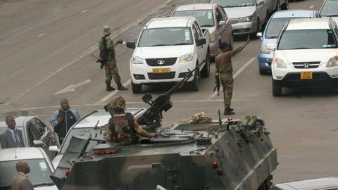 Zimbabwe army seizes power, Mugabe confined to home