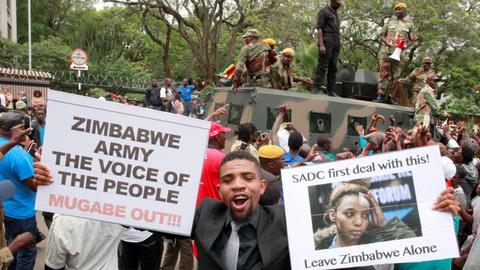 Why Zimbabweans marched with the military