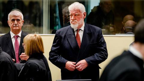 Bosnian-Croat war criminal dies after drinking poison in UN court