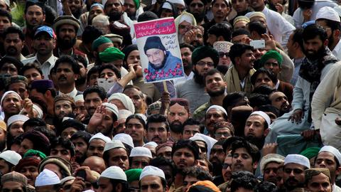Why does a Pakistani assassin inspire anti-government demonstrators?
