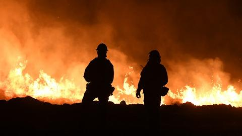 California firefighters make gains ahead of strong winds