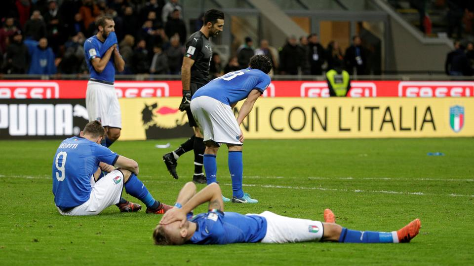Italy players look dejected after the match. Reuters