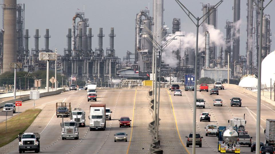Shell Oil Company's Deer Park refinery and petrochemical facility is shown in the background as vehicles travel along Highway 225 on November 21, 2007 in Texas.