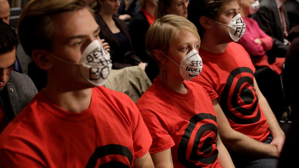 Anti-nuclear war protesters sit in a hearing of the US Senate Foreign Relations Committee about presidential authority to use nuclear weapons on Capitol Hill in Washington