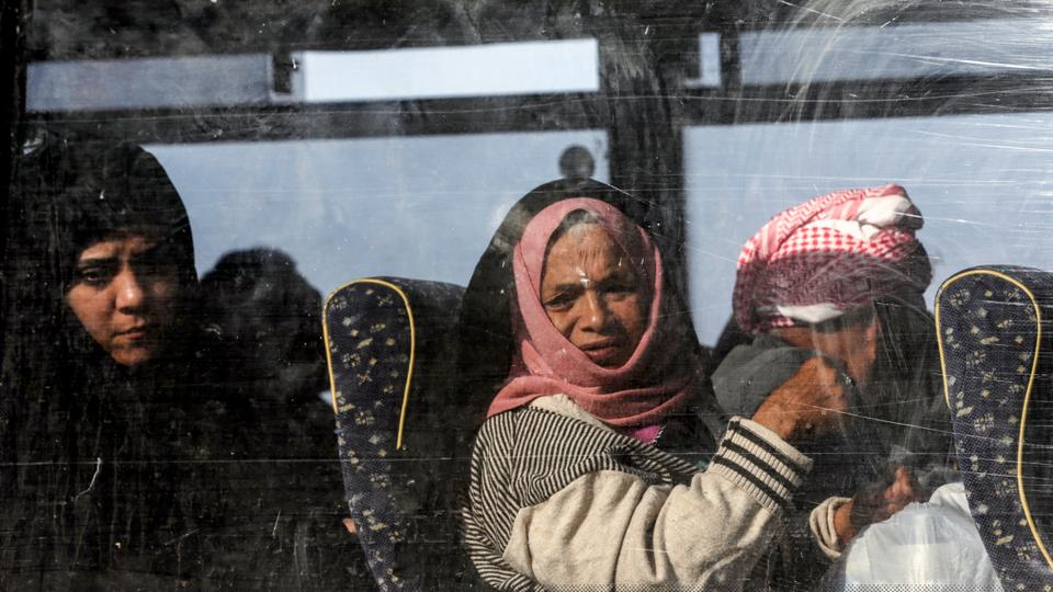 Palestinians ride in a bus in Khan Younis in the southern Gaza strip prior to their departure for the Rafah border crossing with Egypt