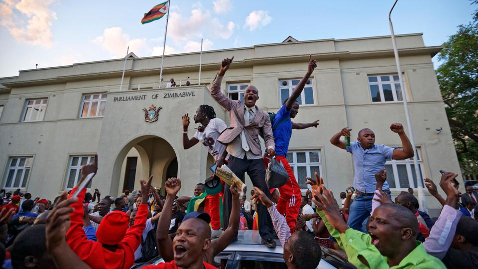 Zimbabweans celebrate outside the parliament building immediately after hearing the news that President Robert Mugabe had resigned, in downtown Harare, Zimbabwe Tuesday, November 21, 2017. (Photo AP)