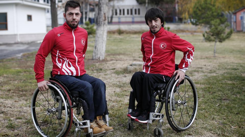 Abdullah Ozturk (L) and Ali Ozturk (R) pose for a photo on December 3, 2017 in the Turkish capital Ankara, Turkey.