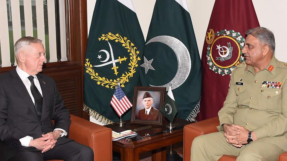 his handout photo released by Pakistan's Inter Services Public Relations (ISPR) on December 4, 2017 shows Pakistani Army Chief General Qamar Javed Bajwa (R) speaking with US Defence Secretary Jim Mattis during a meeting in Rawalpindi, Pakistan.