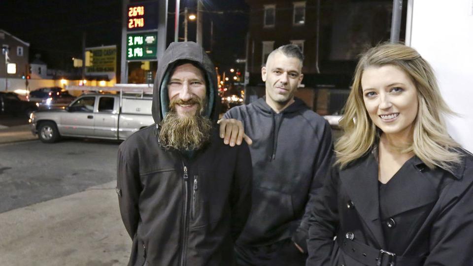 Johnny Bobbitt Jr., left, Kate McClure, right, and McClure's boyfriend Mark D'Amico pose at a Citgo station in Philadelphia, November 17, 2017. (File photo)