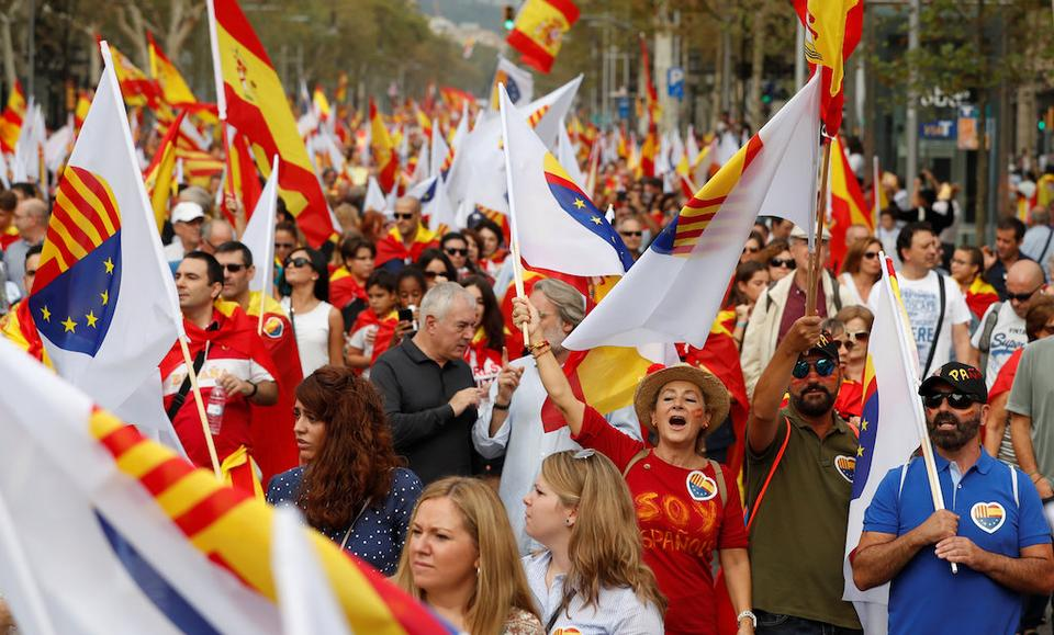 People shout slogans during Spain's National Day in Barcelona, Spain, October 12, 2017.