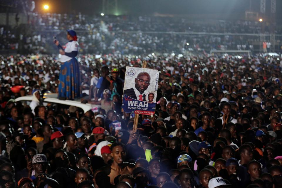 Supporters of former football player and presidential candidate of CDC (Congress for Democratic Change) George Weah attend a meeting during the party's presidential campaign rally at the Antoinette Tubman Stadium in Monrovia, Liberia. October 6, 2017.