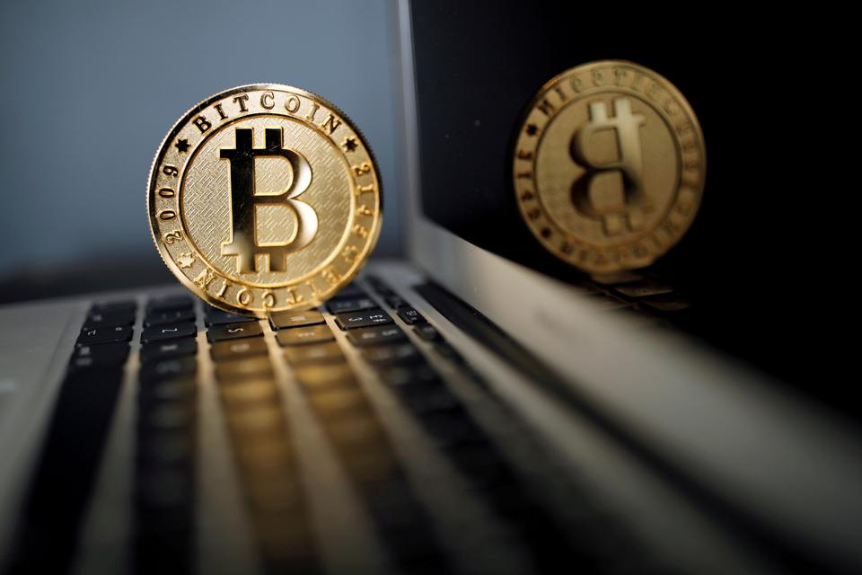 A Bitcoin (virtual currency) coin is seen in an illustration picture taken at La Maison du Bitcoin in Paris, France, June 23, 2017.
