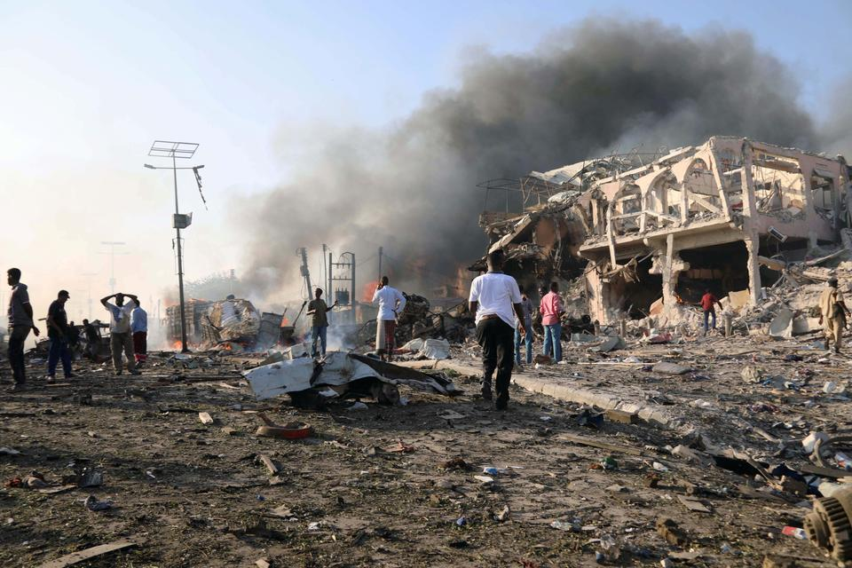 Ambulance sirens still echoed across Mogadishu as bewildered families wandered in the rubble of buildings, looking for missing relatives.