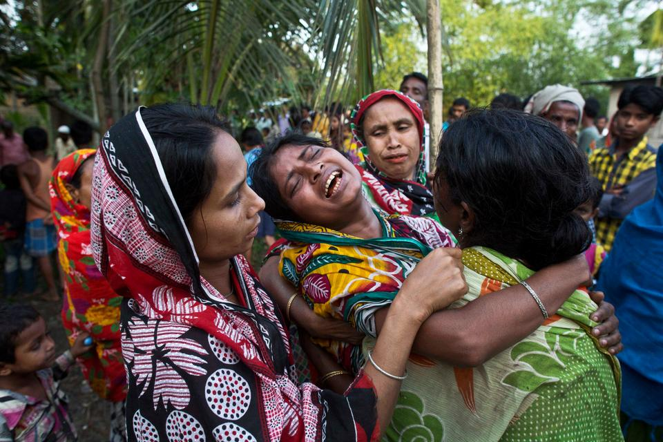 Relatives of Abu Hanif, who was beaten to death by a mob, mourn during his funeral in Naramari village, about 140 kilometers east of Gauhati, in the Indian state of Assam on May 1, 2017. Two Muslim men, including Hanif, were beaten to death by a mob over allegations of cow theft, the latest in a series of similar attacks across the country, police officials said Monday. Human Rights Watch said in a report last week that since Prime Minister Narendra Modi's government took office at least 10 Muslims, including a 12-year-old boy, have been killed in mob attacks in seven separate incidents related to allegations over cows.