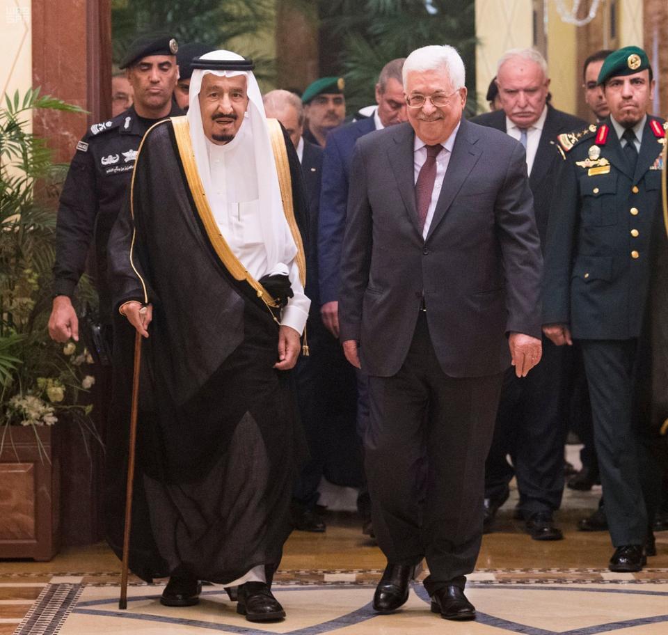 Saudi Arabia's King Salman bin Abdulaziz Al Saud walks with Palestinian President Mahmoud Abbas during a reception ceremony in Riyadh.