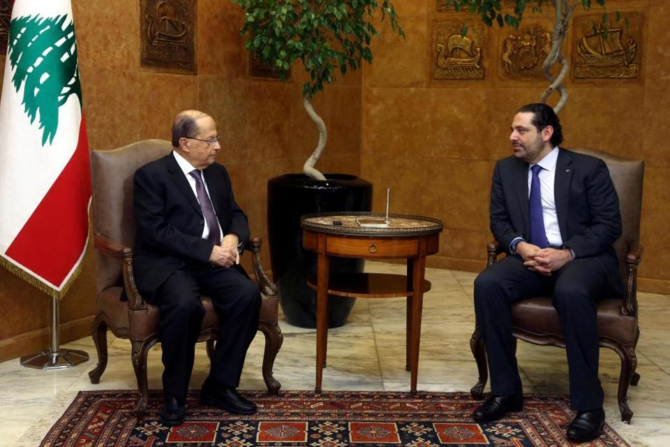 Lebanon's President Michel Aoun (L) and Prime Minister Saad Hariri. Hariri's resignation risks exacerbating tensions in Lebanon,  and returning it to paralysis in government.